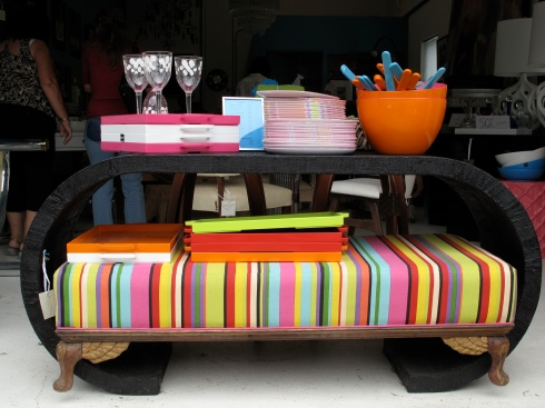 19th century Anglo-Indian ottoman newly upholstered in a multi-colored stripe is $2,000