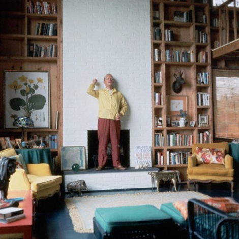 Truman Capote Standing by Fireplace
